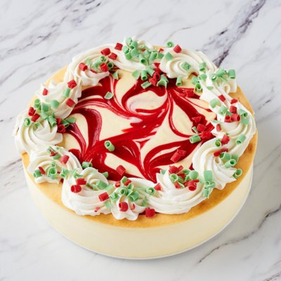 Strawberry Swirl White Chocolate Cheesecake on table